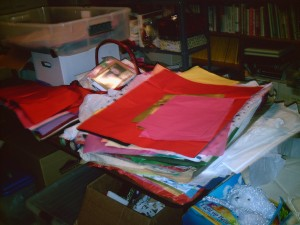 BEFORE: Gift wrapping room - tissue paper and supplies in lumps and piles all around.